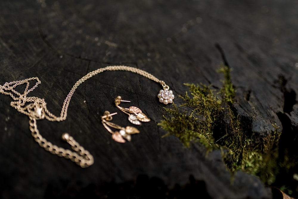 gold-colored chain necklace and pair of earrings set