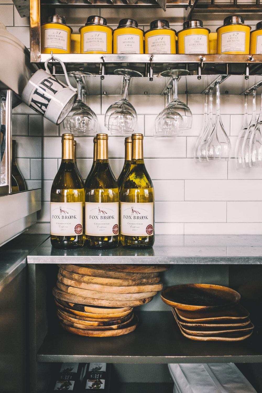 six wine bottle on top dough table