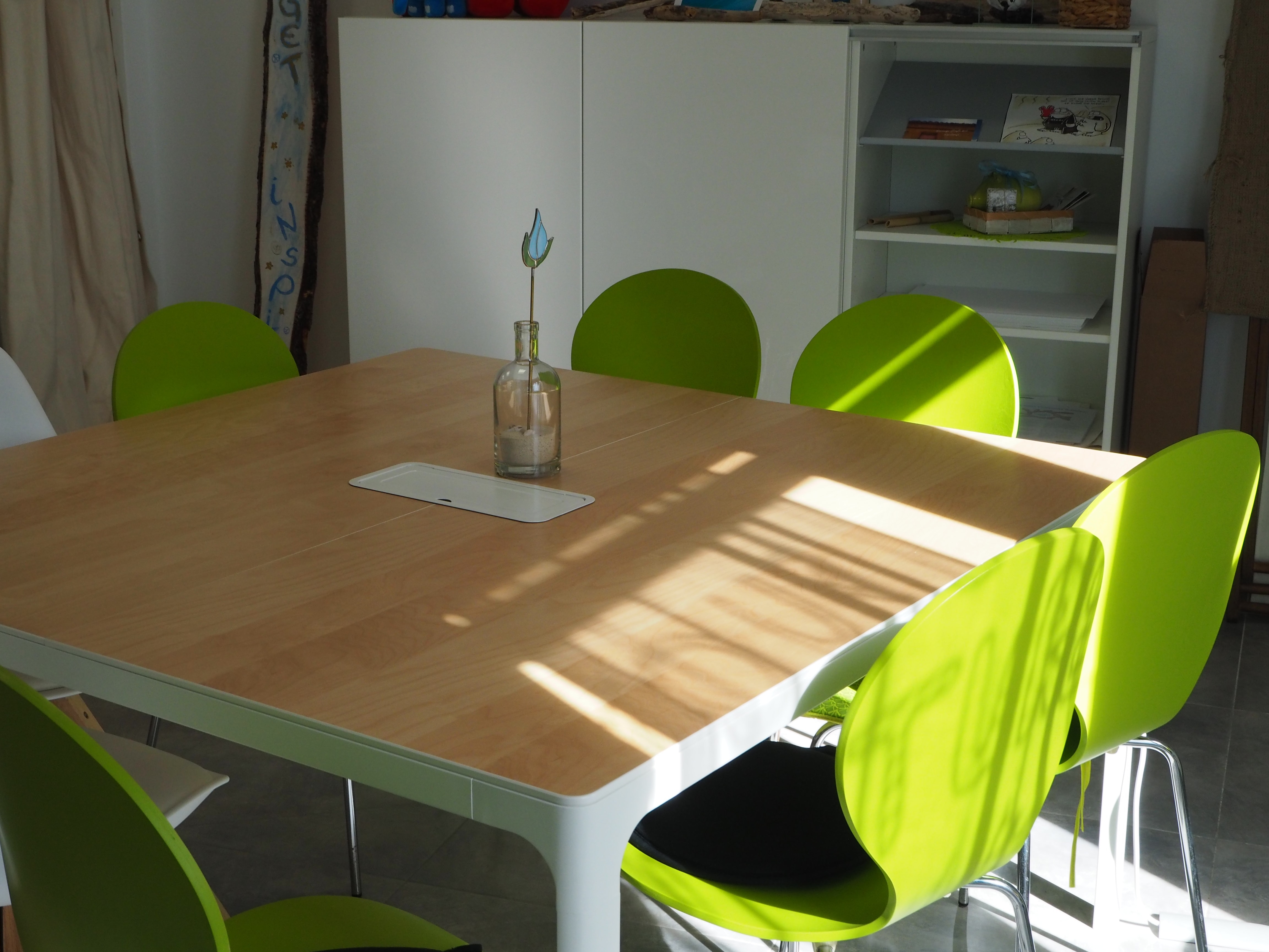 green and white wooden dining table set
