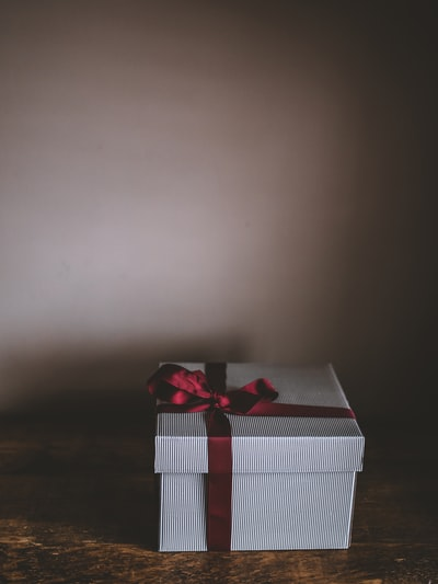 white box with red ribbon