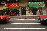 cars travelling near storefront