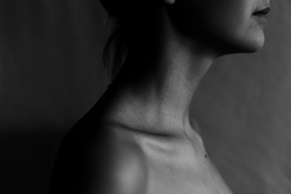 grayscale photography of woman collar bone