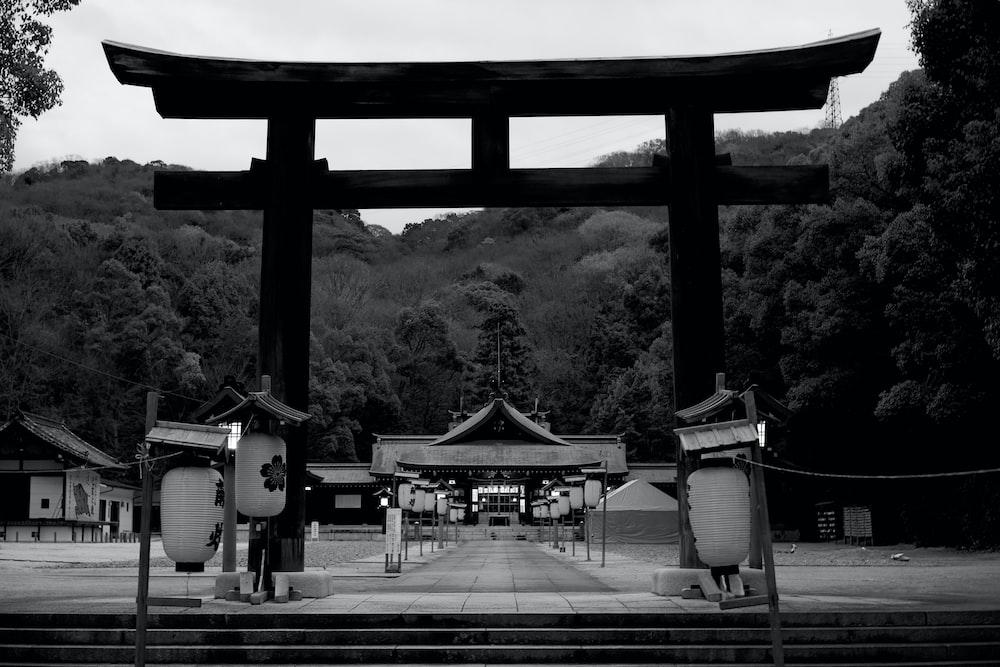black pagoda in greyscale photography