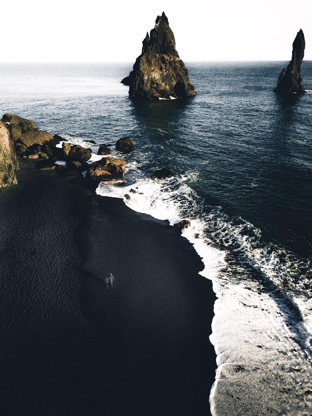 brown cliffs on ocean