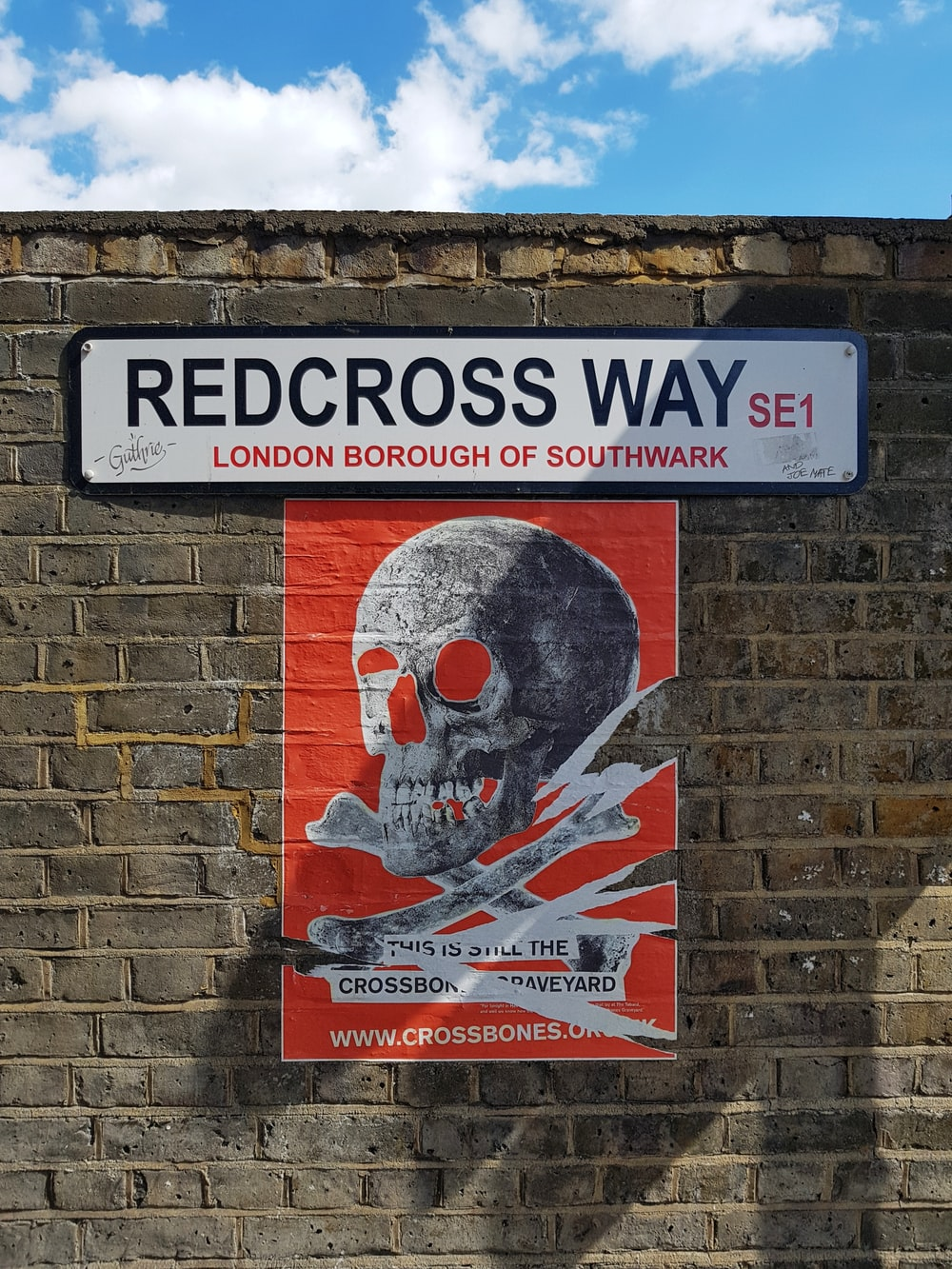 redcross way signage on concrete brick wal