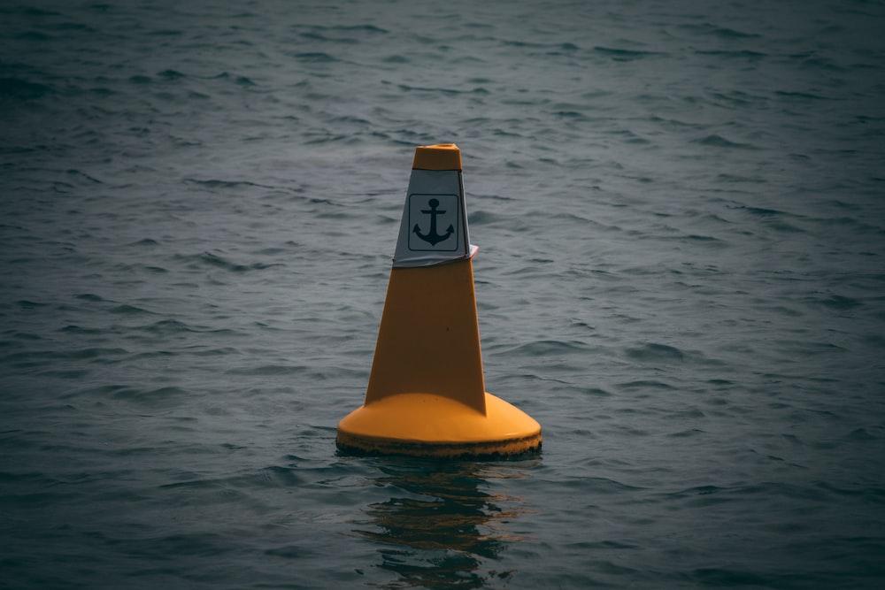 orange and white water buoy