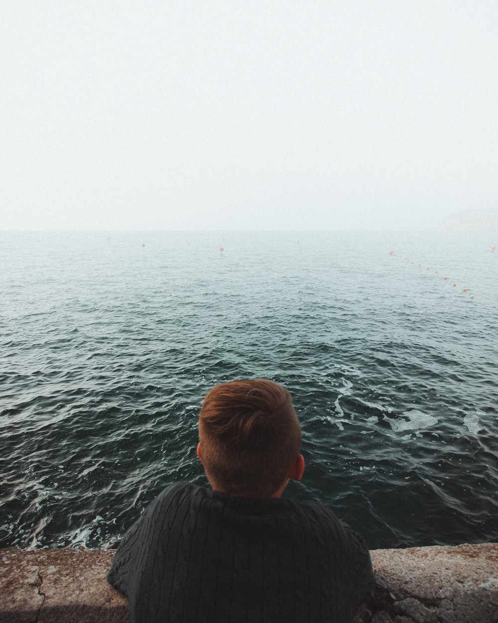 person looking at ocean during daytime