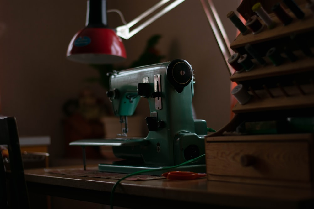 green sewing machine on table