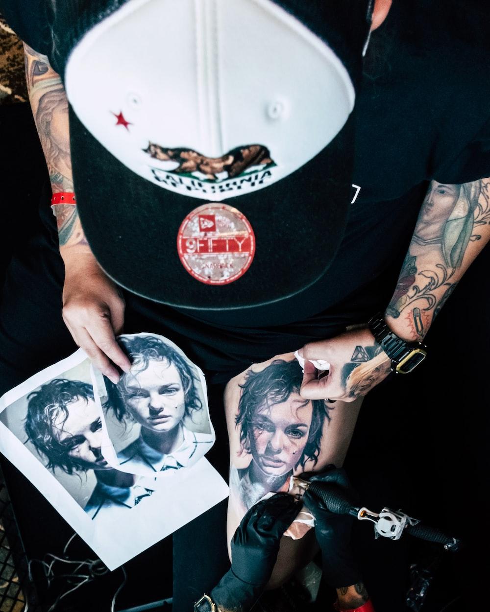 man having tattoo
