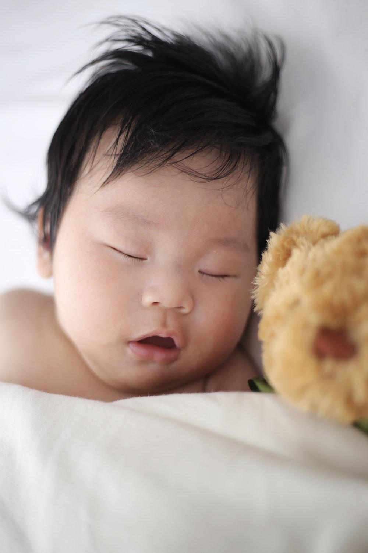 baby sleeping on pillow
