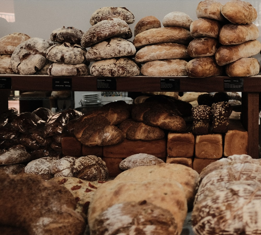 baked breads on brown wooden rack