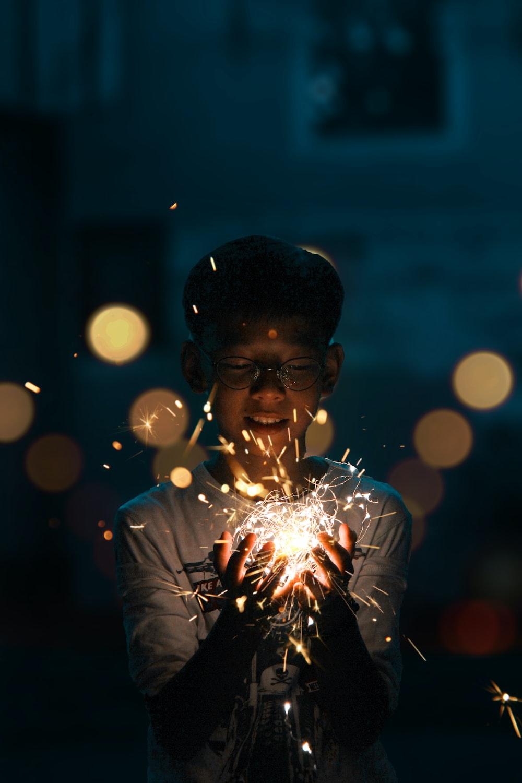 Boy Holding Lighting Ers Photo