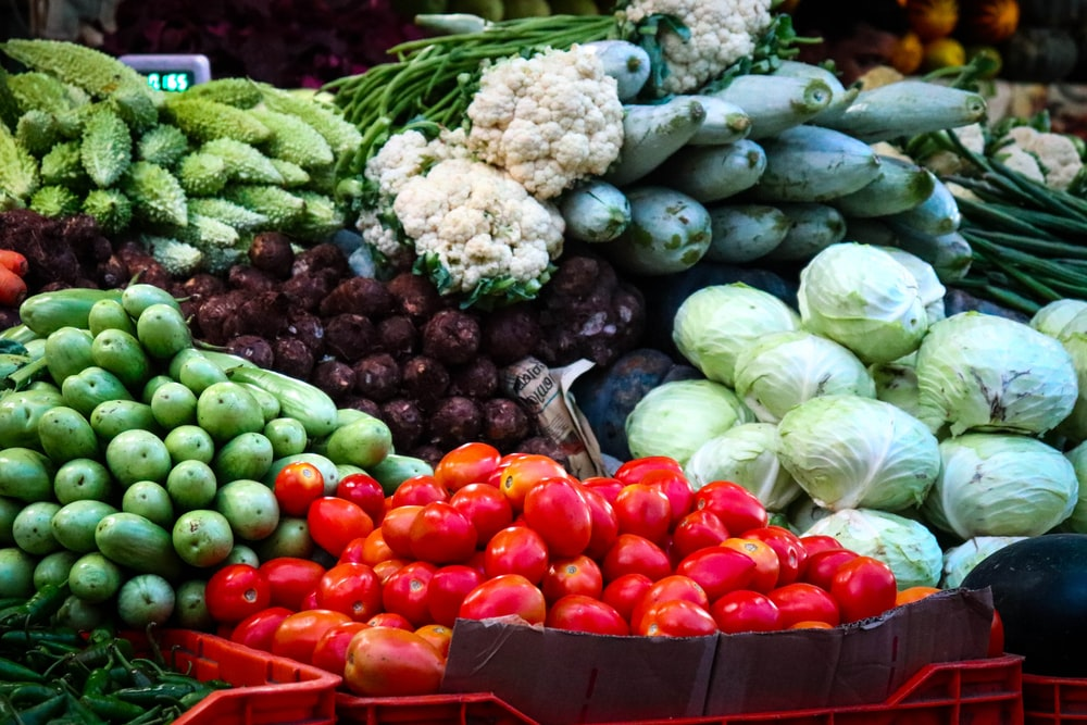 low light photography of pile of vegetables