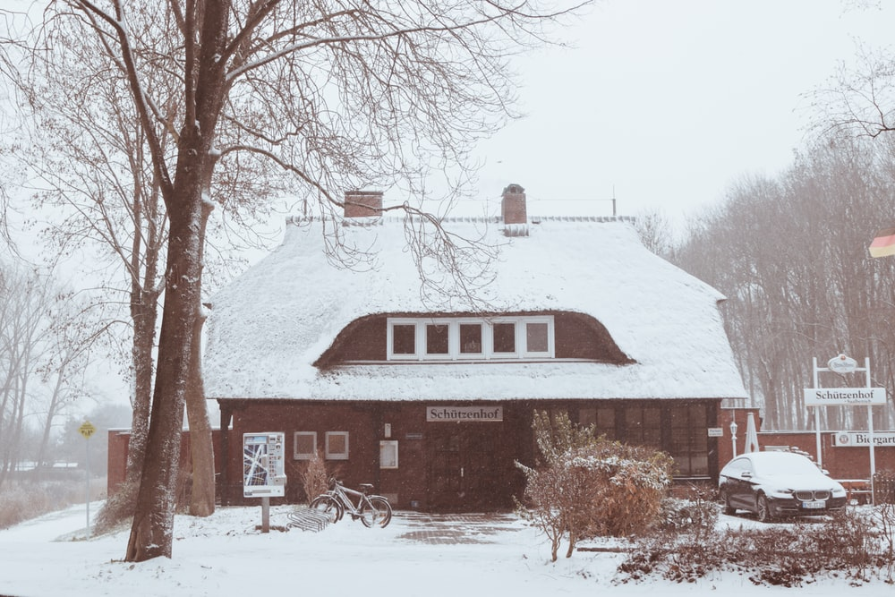 brown house covered with snow