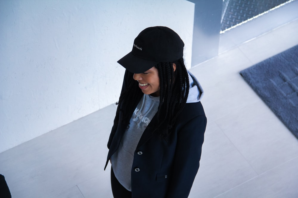 woman wearing black cap