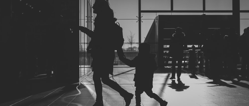 silhouette of woman holding child