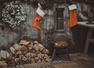 firewood in black chiminea