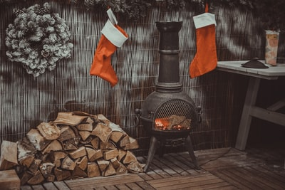 firewood in black chiminea stocking teams background