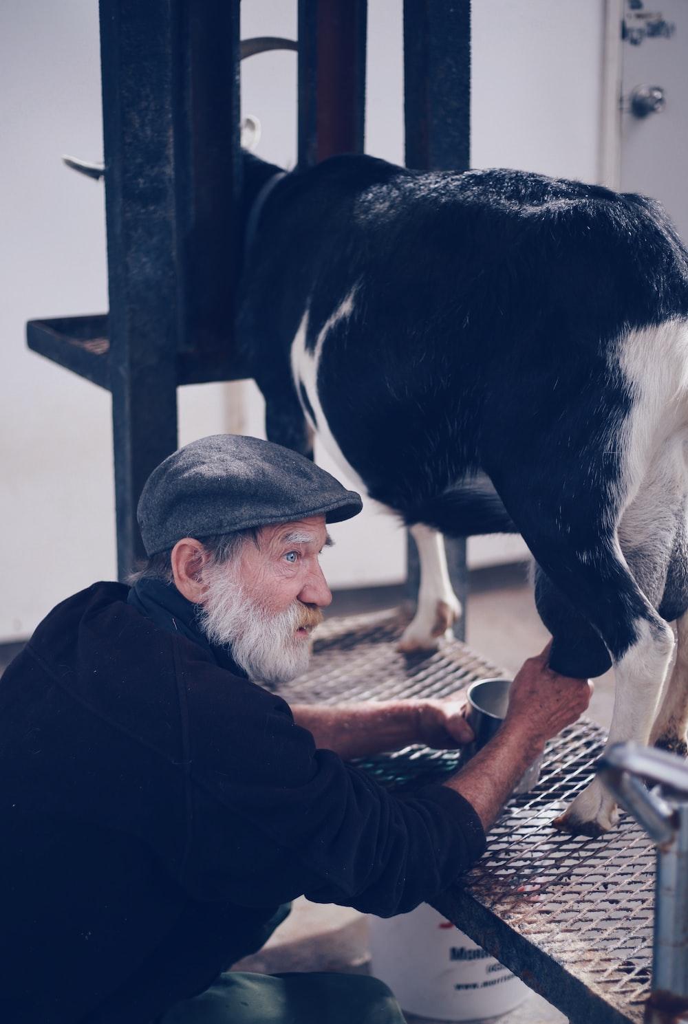 man holding goat