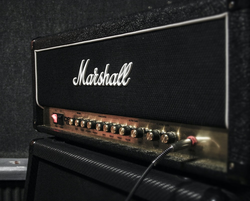 cable plugged in Marshal guitar amplifier