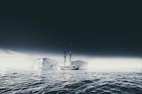 boat on body of water near ice berg