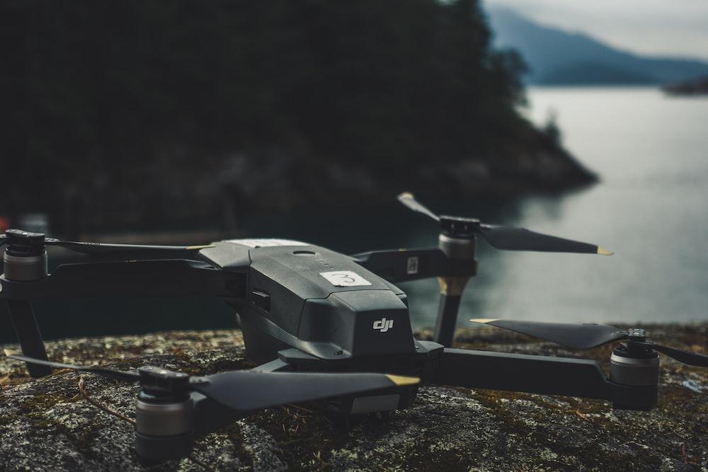black quadcopter on rock