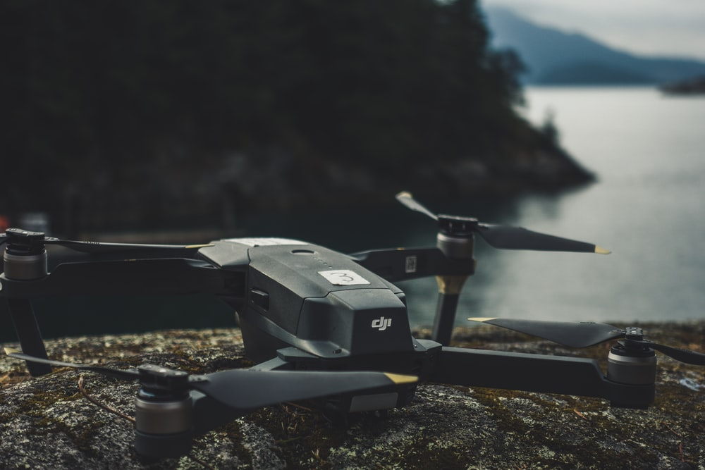 black quadcopter on rock