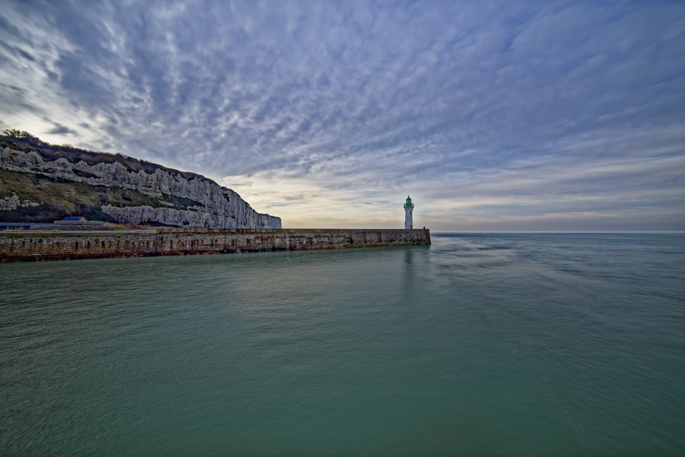 lighthouse beside sea