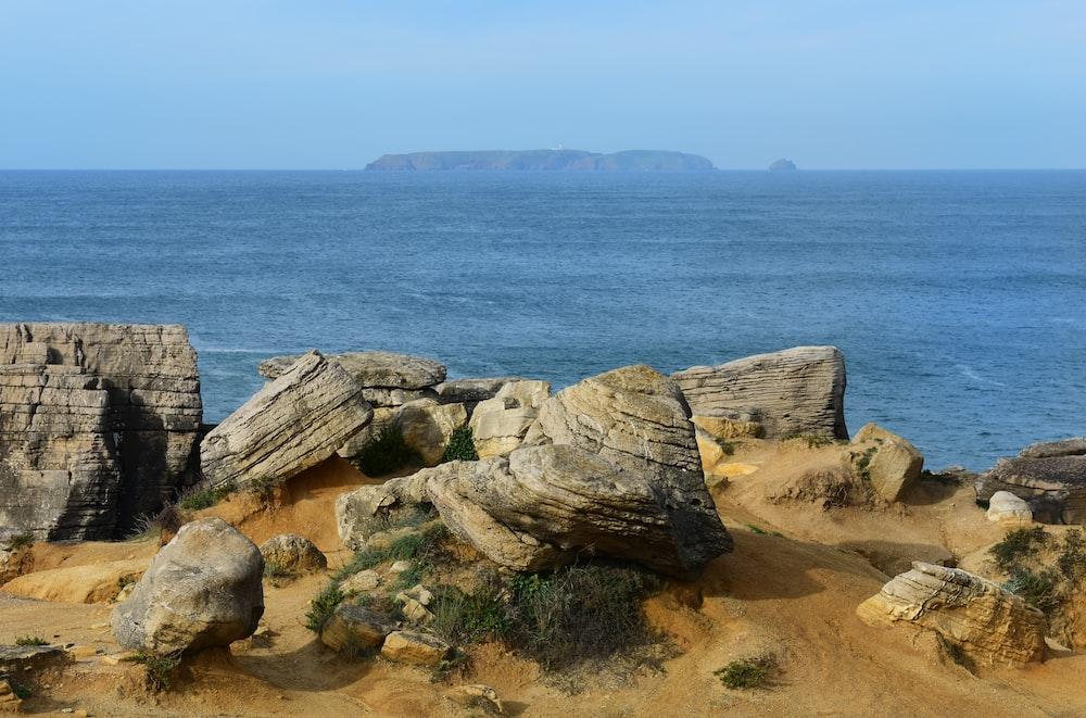 gray rock formation near water
