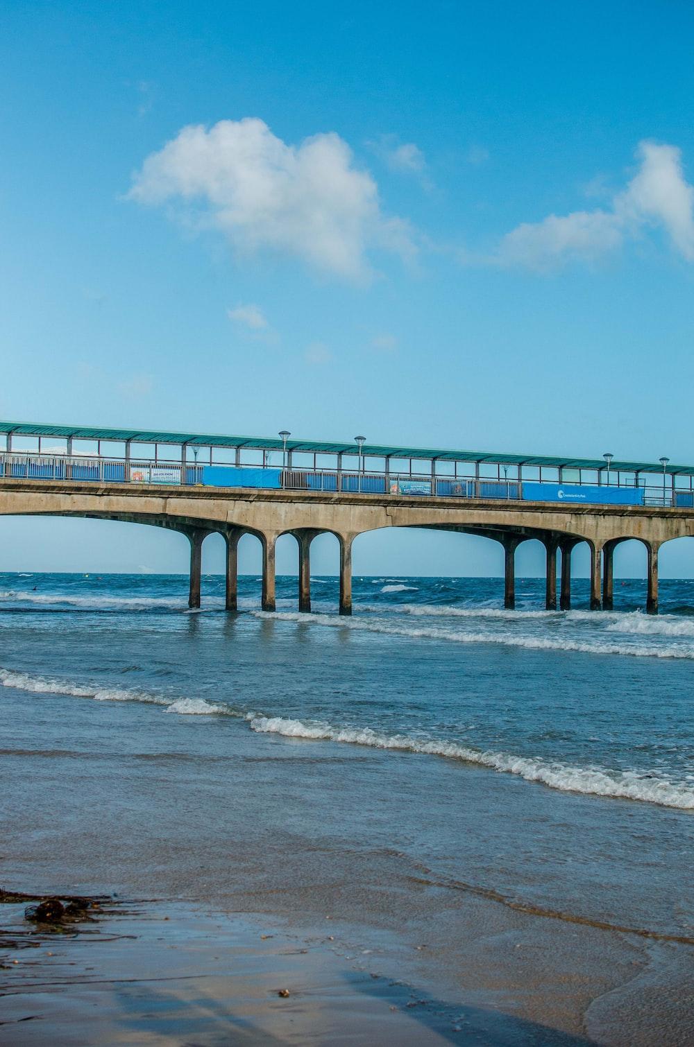 brown concrete bridge under blue skyt