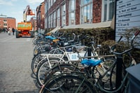 bicycles parked beside building