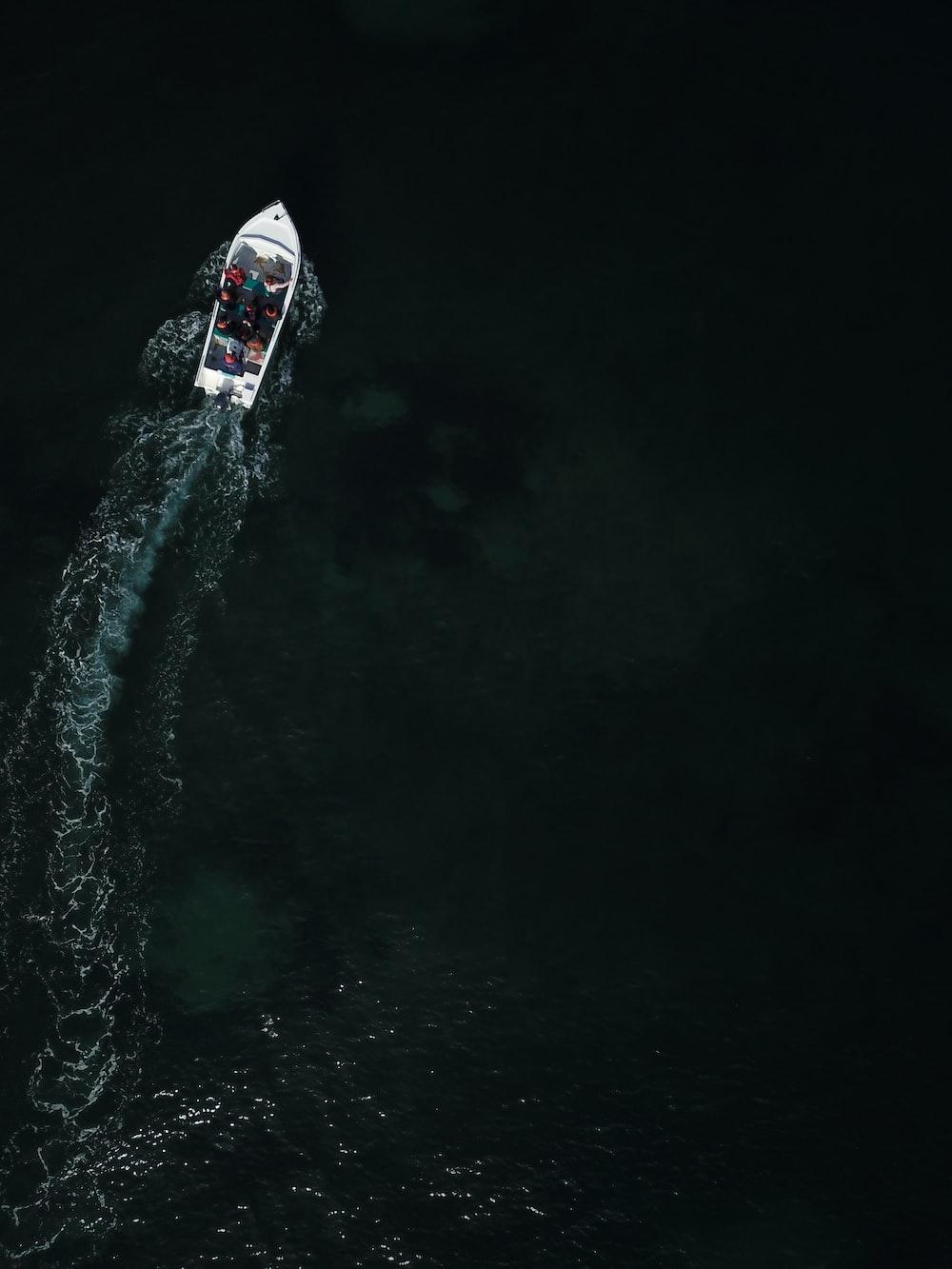 bird's-eye-view photo of white boat
