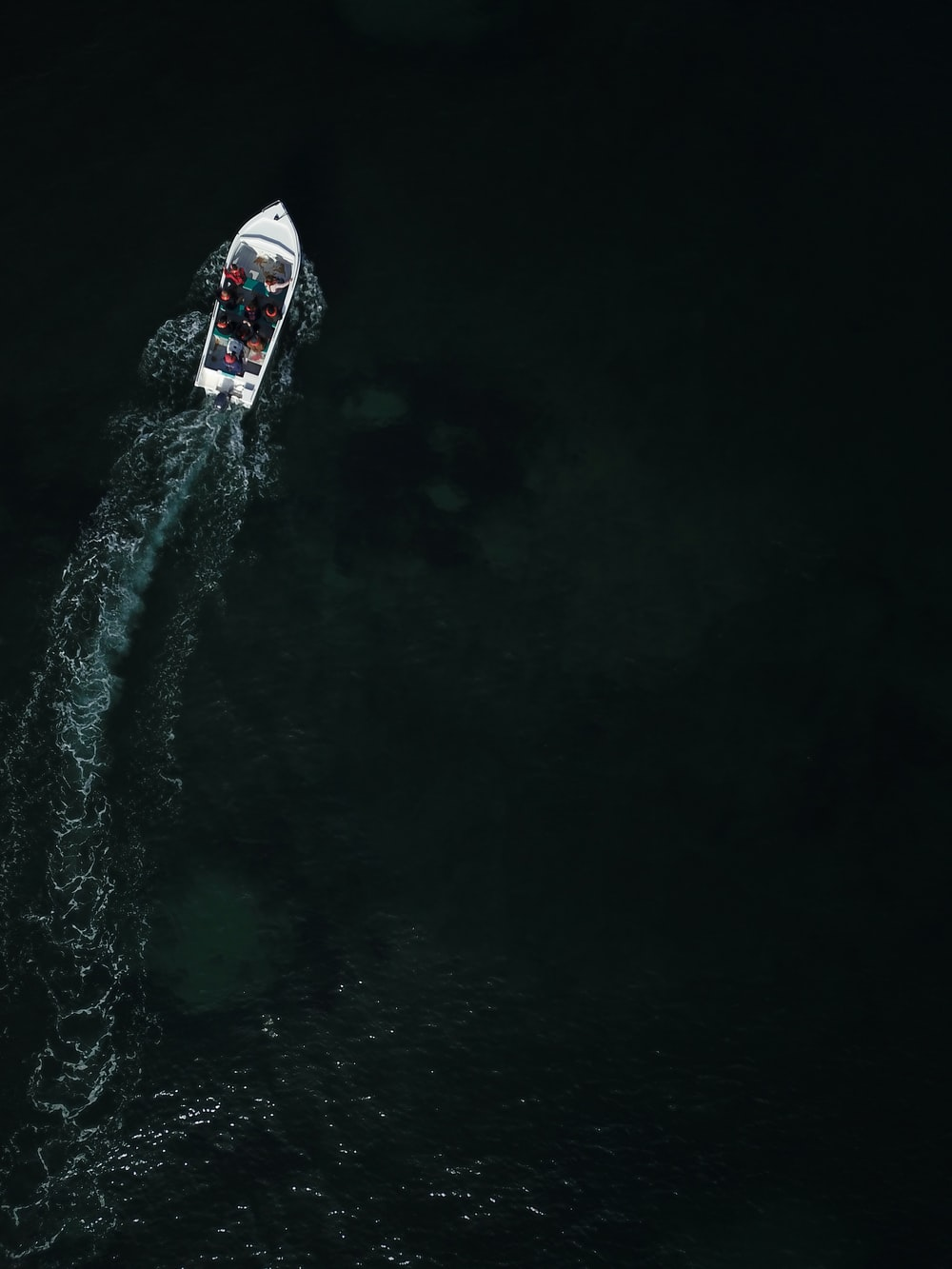 bird's-eye-view photo of white boat