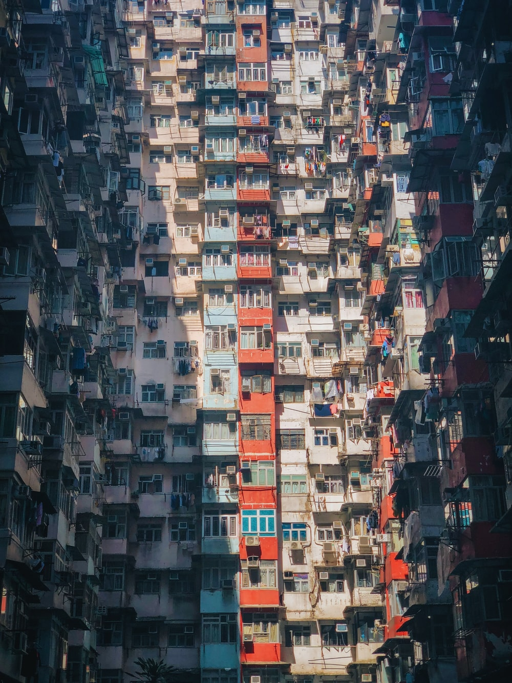white and red high-rise building