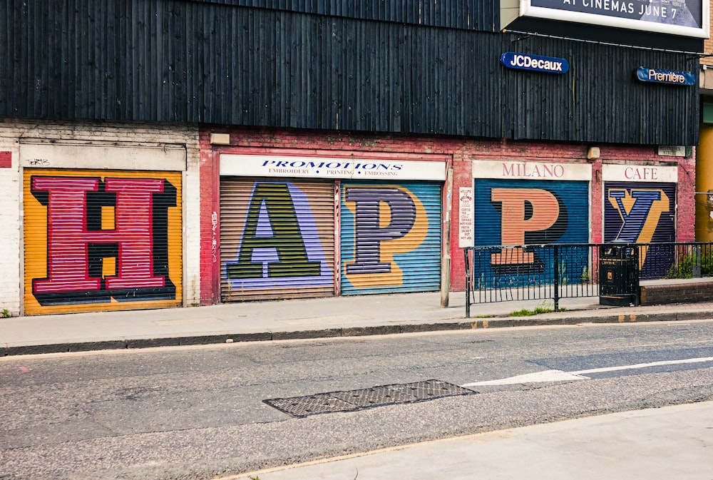 multicolored HAPPY roll-up door graffiti