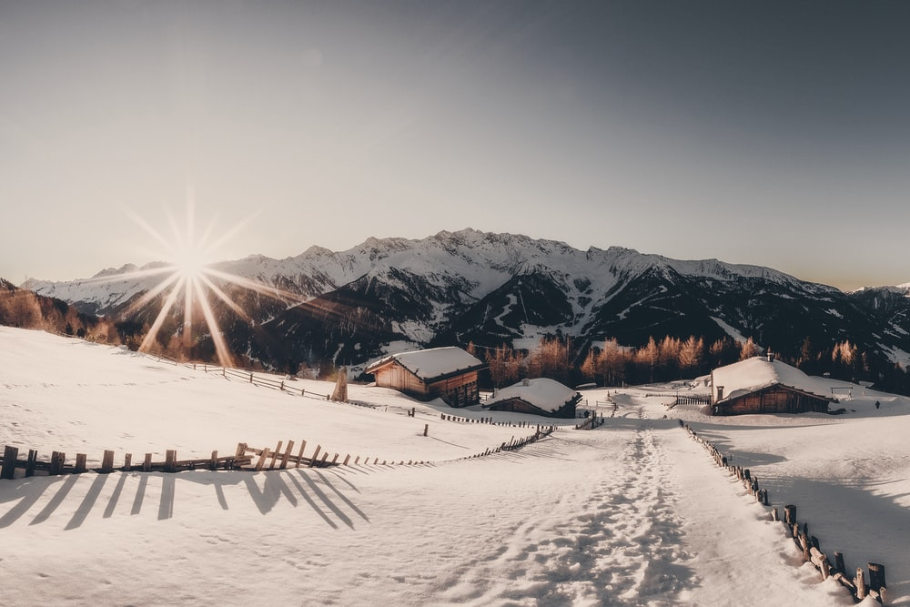 houses near mountain with snow
