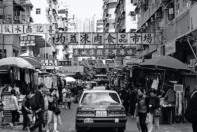 Taxi driving through street market