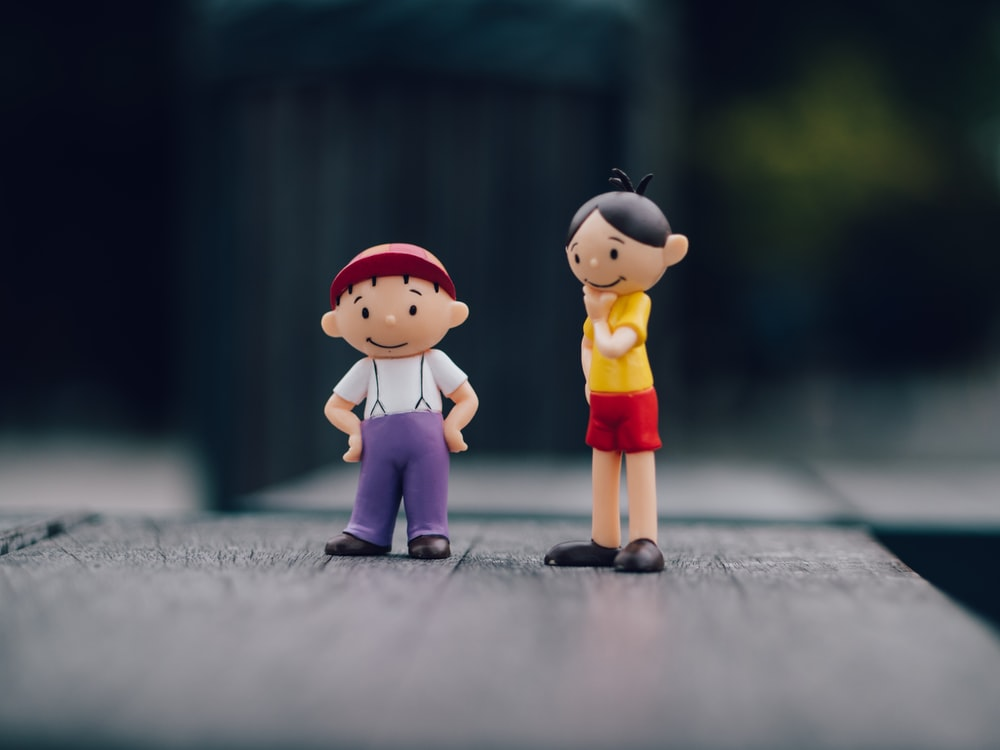 two boy and girl plastic toys