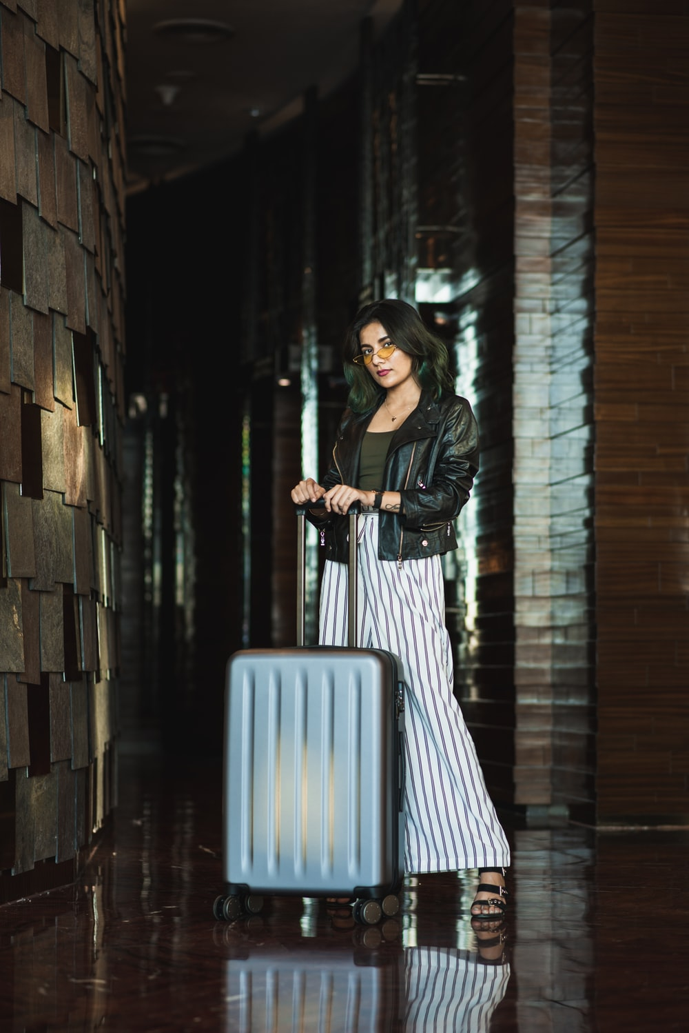 standing woman front of luggage