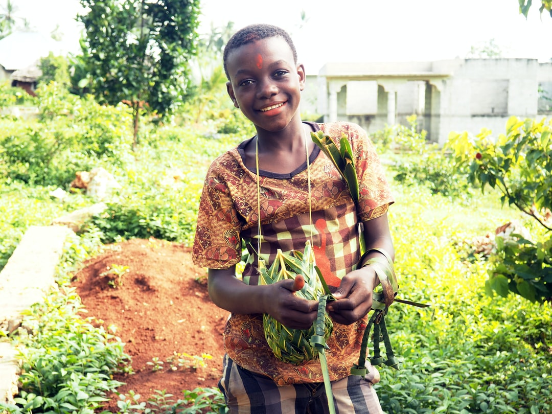 Boy with Annatto seeds powder as make up