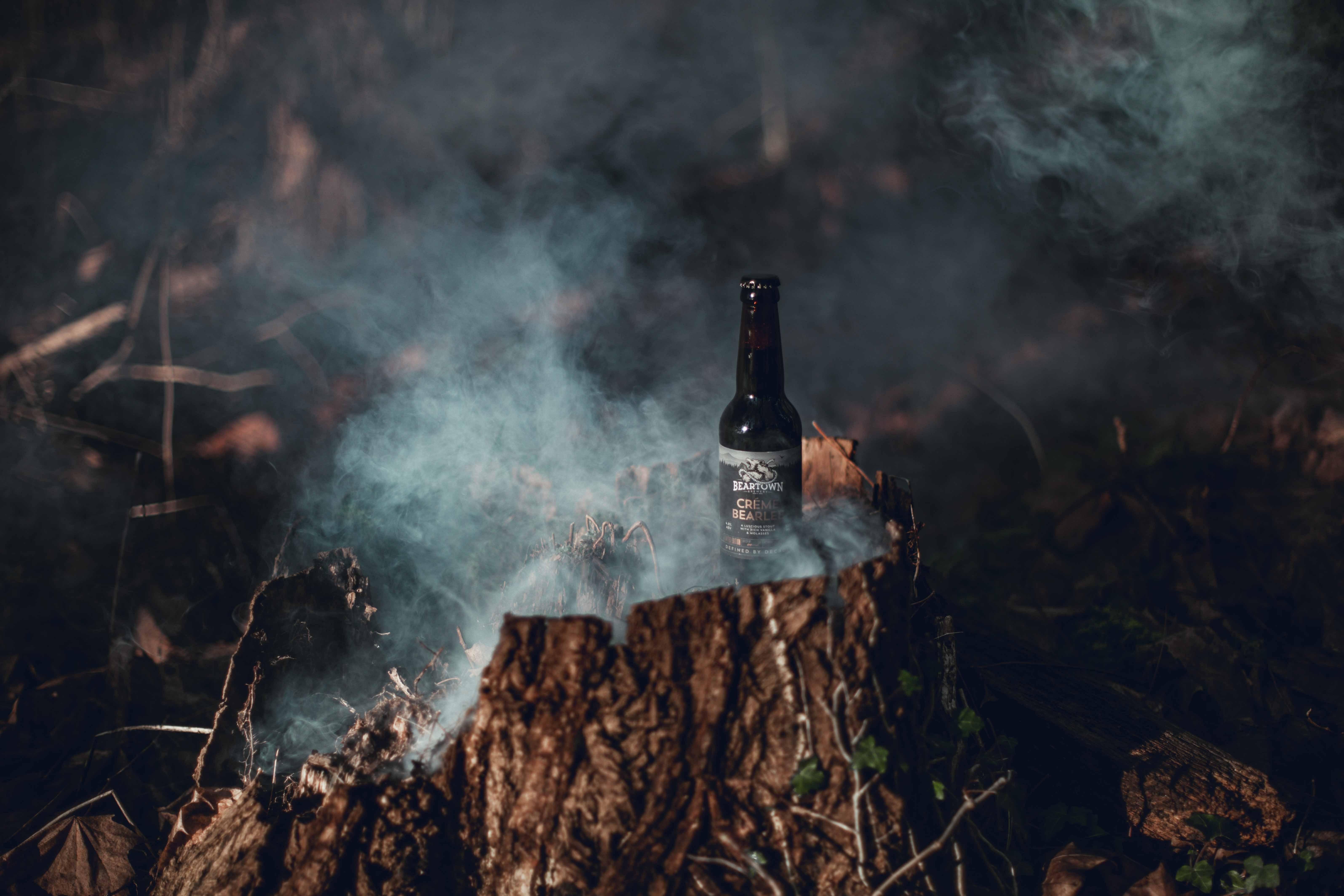amber glass bottle of tree slab