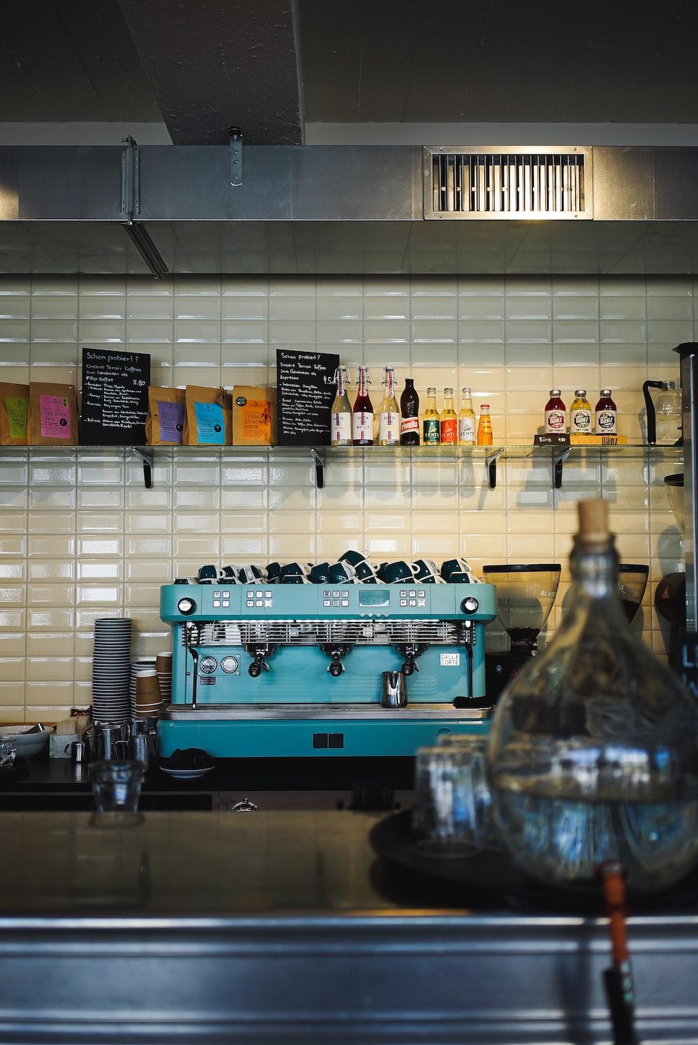blue and black espresso machine