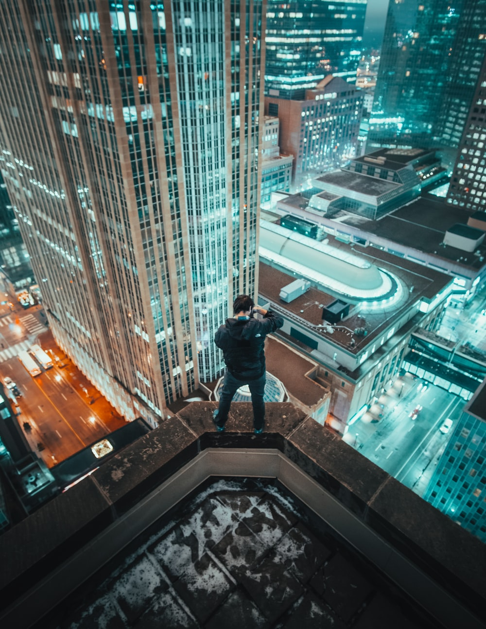 man standing on edge of building