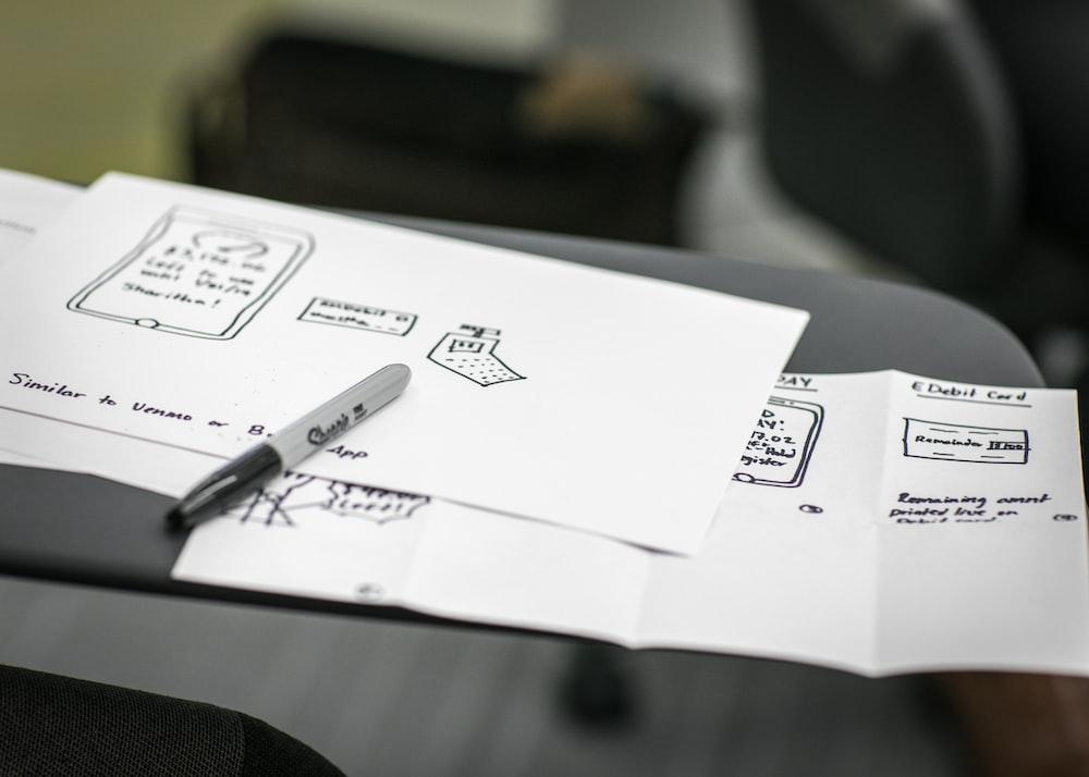 black marker on white printer papers