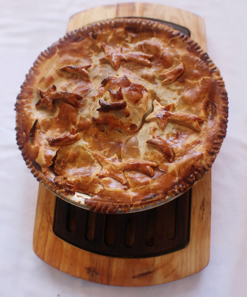 pie on brown wood slab