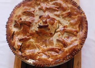 pie on brown wood slab
