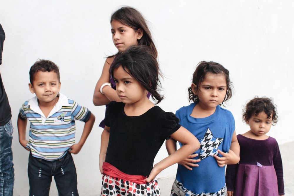 five children wearing assorted-color clothes