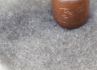 Ball mason glass jar with brown liquid