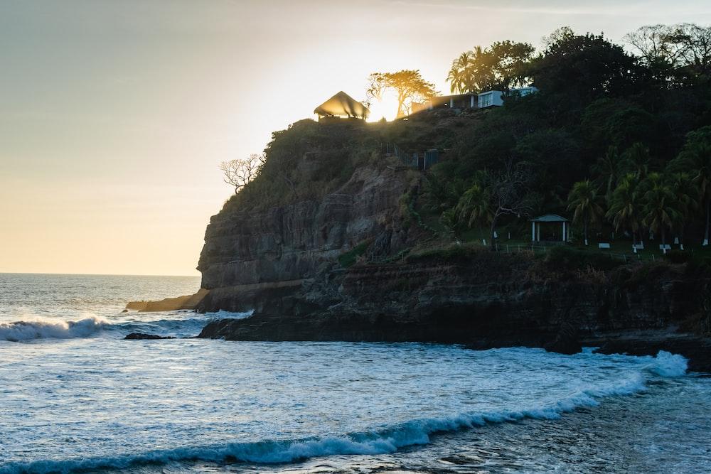 house on beach cliff viewing calm sea