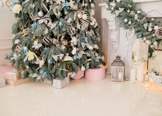 gray candle lantern beside Christmas tree